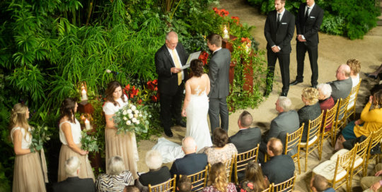 A ceremony in the conservatory.