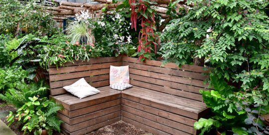 A new seating configuration surrounded by greenery in the Gardeners Show House.