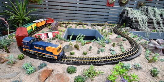 "A look at the ""desert"" side of our holiday train, complete with sand, cacti and other succulent plants."