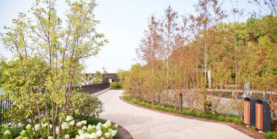 The path along the perimeter of the Ruan Reflection Garden boasts Des Moines River views and thoughtful plantings.